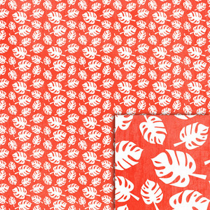 red monstera leaves background paper