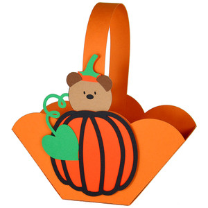 teddy in a pumpkin halloween basket