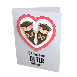 folded card with layered otters