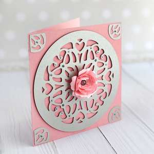 elegant card with doily and flower