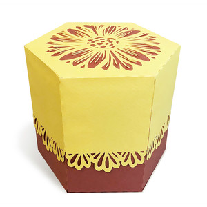 box with golden daisy