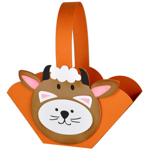 kitty in a cow costume halloween basket